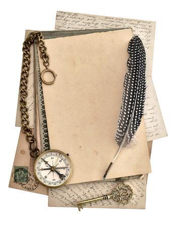 vintage papers and postcards isolated on white background  antique feather pen and compass  journey concept photo