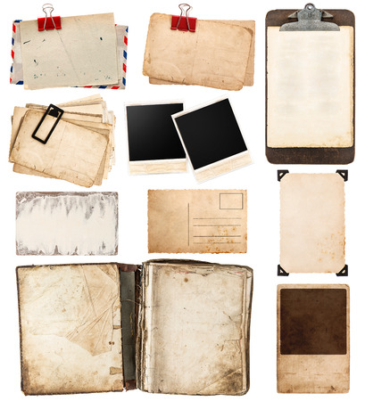 pile of old postcards isolated on white background. vintage paper sheets with clip. old photo frames. antique clipboard. retro design photo