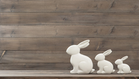 easter bunny: easter bunny over rustic wooden background. retro style toned picture