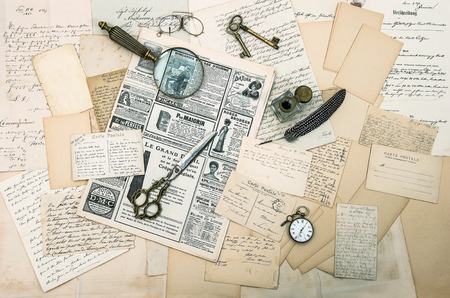 antique accessories, old letters and postcards, vintage ink pen  nostalgic sentimental background  ephemera and newspaper Editorial