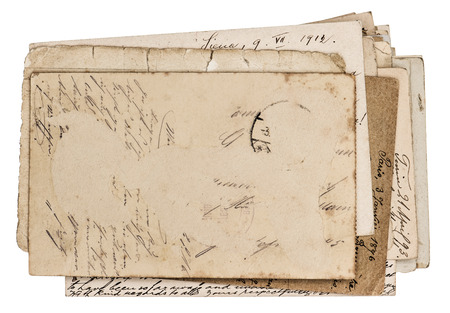 pile of antique postcards isolated on white background  grungy paper texture photo
