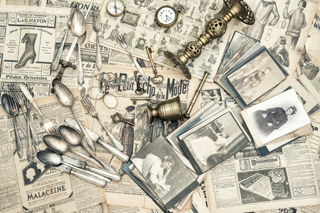 rarity: Antique rarity goods, private collection  Old cutlery, clock, key, photos  Collectibles  Shabby chic Stock Photo