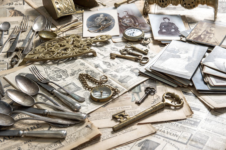 collectibles: Antique rarity goods, private collection  Old cutlery, clock, key, photos  Collectibles  Shabby chic Stock Photo