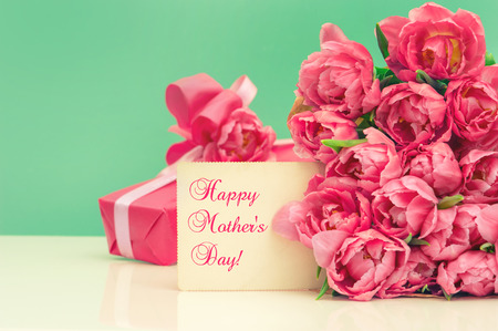 Pink tulips, gift ang greeting card with sample text Happy Mother