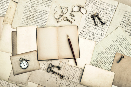 antique office tolls and keys, old diary book and letters  nostalgic sentimental background photo