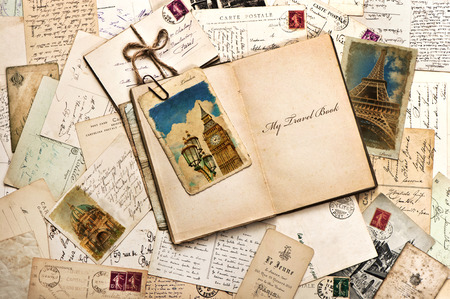old postcards, letters, mails and open journal with sample text My Travel Book vintage style travel background