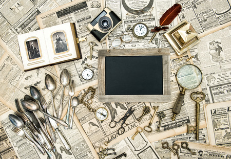 Vintage collectible goods from ca  1900  Keys, photos, cutlery  Blackboard for your text photo