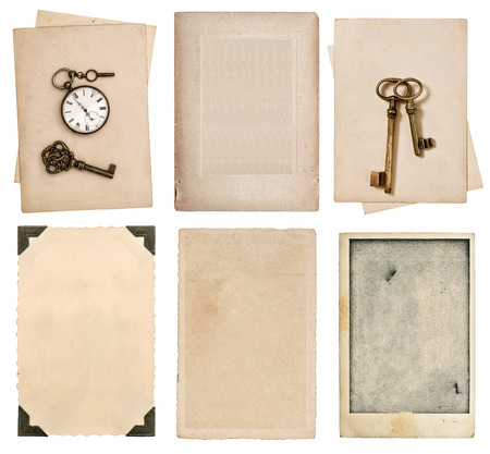 aged paper sheets and vintage photo cards isolated on white background photo