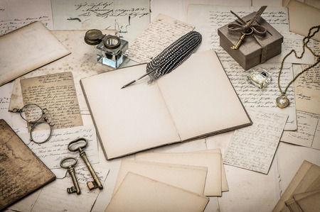 open diary book, old letters, office supplies and antique accessories photo