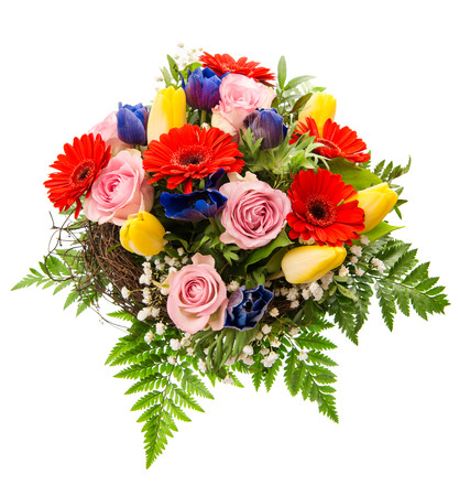 closeup of colorful spring flowers bouquet isolated on white background  pink roses, red gerbera, yellow tulips, blue anemone
