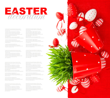 festive decoration with white red painted easter eggs and green grass over table cover  white background with sample text photo