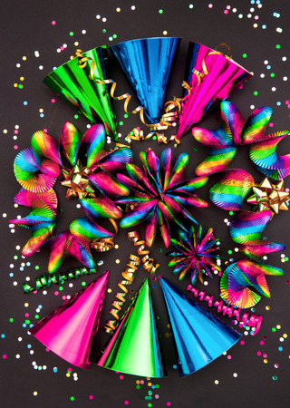 colorful garlands, streamer, hats and confetti  multicolor party decoration background photo