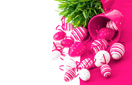 colorful white pink painted easter eggs with green grass over table cover  festive composition with space for your text photo