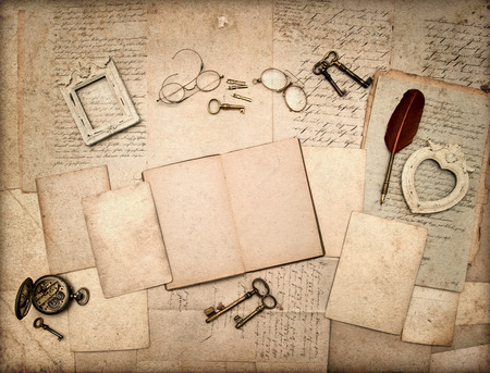 old letters: open book, vintage antique accessories and old letters  nostalgic sentimental background grungy textured