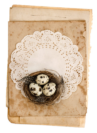 old paper sheets with easter eggs decoration isolated on white background photo