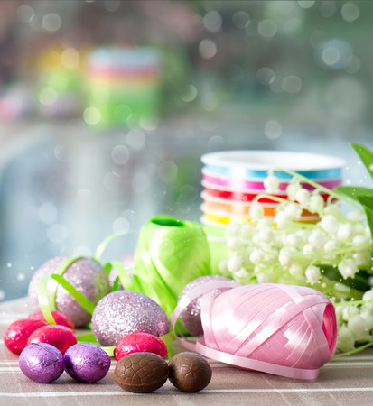 chocolate eggs and spring flowers  easter decoration photo