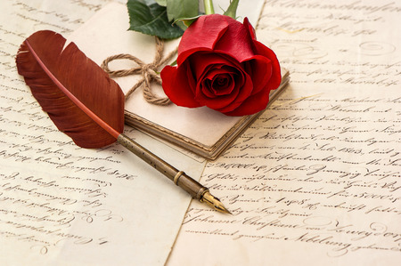 old letters: old letters, rose flower and antique feather pen  romantic vintage background  selective focus Stock Photo