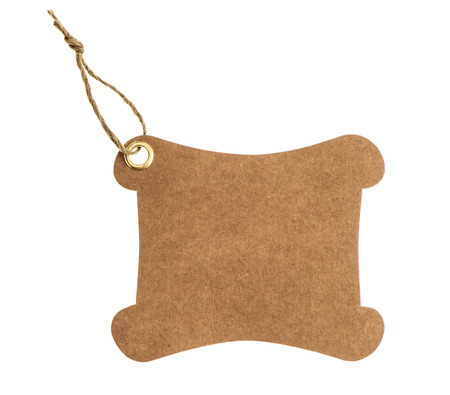 brown paper tag with metal rivet isolated on white background photo