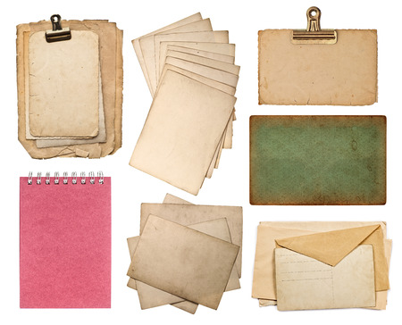 dirty sheet: set of various old paper sheets  vintage photo album and book pages, cards, pieces isolated on white background