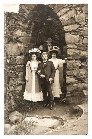 group of wealthy high society men and women in old castle,\ circa 1915 in Baden-Baden, Germany