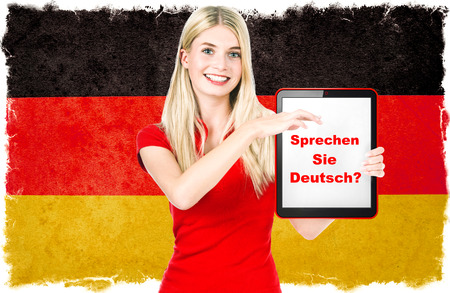 german girl: Young woman holding tablet pc  National flag of Germany at the background  German language learning concept  Collage  Clip-Art Stock Photo