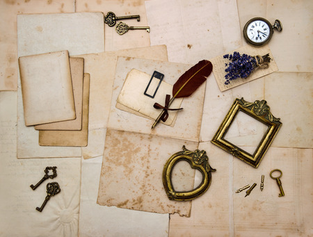 vintage things, picture frames, keys, flowers, old letters and photos  nostalgic sentimental paper background photo
