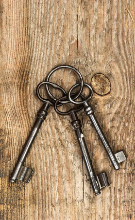 antique keys over dirty vintage wooden background photo