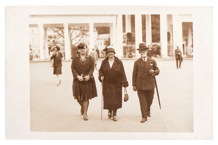 antique street portrait of a wealthy family wearing vintage clothing, circa 1920 in Berlin, Germany