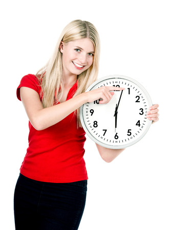 young beautiful woman with a clock isolated on white background time management concept