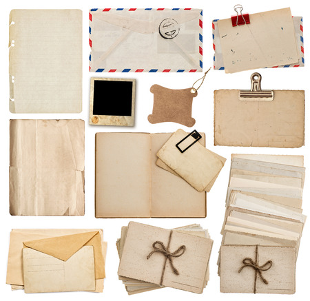 old envelope: set of old paper sheets, book, envelope, postcards isolated on white