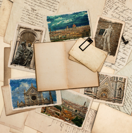 journals: open old book and postcards with pictures of florence over vintage papers travel journal  scrap book Stock Photo