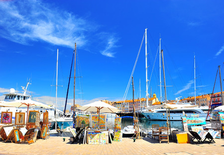 View of Saint Tropez harbor with paint art exhibition and sale on May 24, 2012, Saint Tropez  St  Tropez is famous painter city, many prominent painter lived there, for example Matisse, Signac, Bonnard