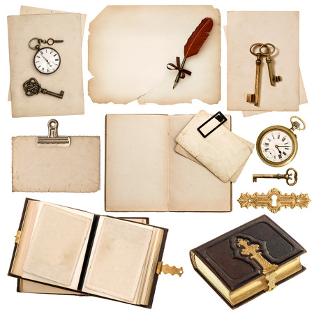 antique book and vintage accessories isolated on white background  old clock, key, postcard, photo album, feather pen photo