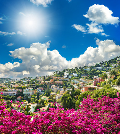 villefranche sur mer: french reviera, view of luxury resort Villefranche-sur-Mer near Nice and Monaco  mediterranean landscape with azalea flowers and beautiful blue sky