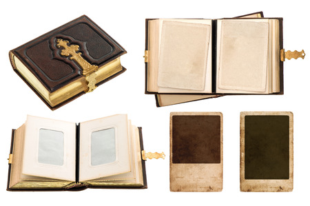 vintage album with retro photo cards  antique book with golden decoration isolated on white background photo