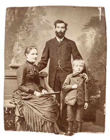 ancestors: BERLIN, GERMANY - CIRCA 1860  antique family portrait of mother, father and son  wearing vintage clothing, circa 1860 in Berlin, Germany Stock Photo