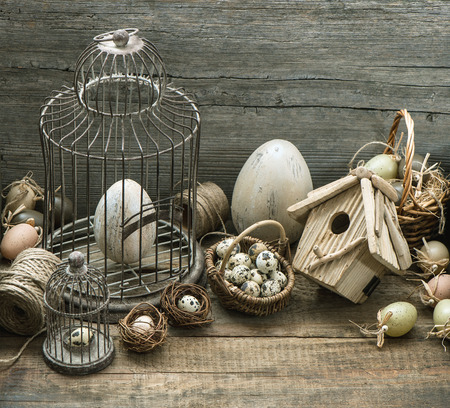 Stock Photo   Vintage Easter Decoration With Eggs, Birdhouse And Birdcage  Nostalgic Still Life Home Interior Wooden Background