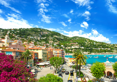 villefranche sur mer: french reviera, view of luxury resort and bay of Villefranche-sur-Mer near Nice and Monaco  mediterranean sea landscape with azalea flowers