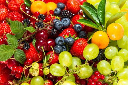 mix of fresh fruits and berries  raw food ingredients  nutrition background