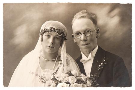 BERLIN, GERMANY - CIRCA 1920  original antique wedding photo  portrait of just married couple  nostalgic picture, circa 1920 in Berlin, Germany Banco de Imagens