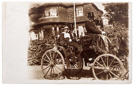 BERLIN, GERMANY - CIRCA 1920  original antique photo with people wearing vintage clothing and old horse-drawn carriage  nostalgic picture, circa 1920 in Berlin, Germany Banco de Imagens