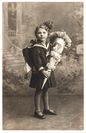 BERLIN, GERMANY - CIRCA 1930  vintage sepia portrait of a first grader school girl with school bag  nostalgic picture, circa 1930 in Berlin, Germany