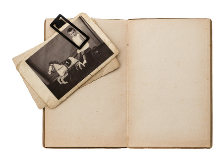 open old book with retro baby picture isolated on white background photo