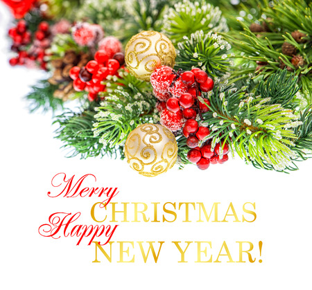nappy new year: christmas tree branch with red berries and golden balls isolated on white background  festive decoration with sample text