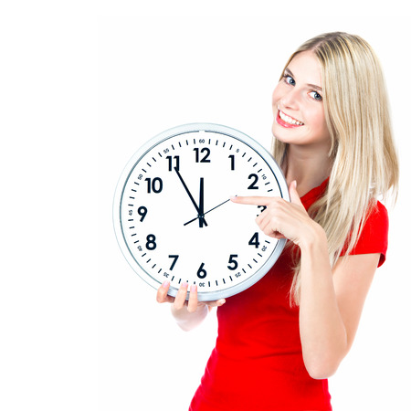 time concept  five to twelve  young beautiful woman with big clock on white background photo