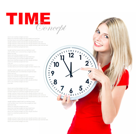 time concept  five to twelve  young beautiful woman with big clock on white background with sample text photo