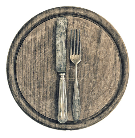 antique silver cutlery and rustic wooden board  kitchen utensils  retro style toned picture photo