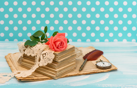 Old love letters and postcards with pink rose flower  Nostalgic sentimental still life  Retro style designed picture photo