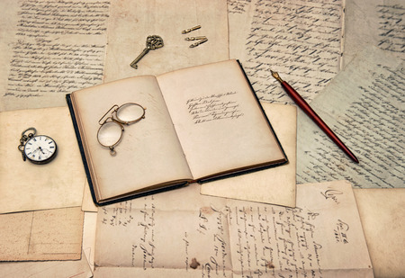 old letters: antique writing accessories, open diary book, old letters and postcards  nostalgic sentimental background Stock Photo