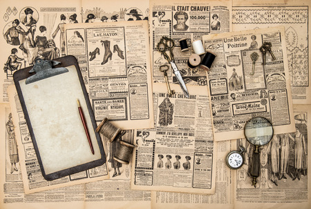 antique accessories, sewing and writing tools, vintage fashion magazine for the woman  retro style toned picture photo
